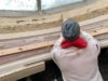 Our craftsman at work, preparing the area for running the cornice.